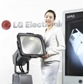 A woman presenting one of LG's lighting solutions