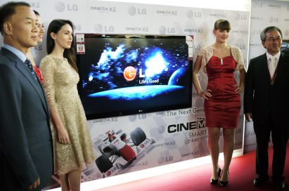 Famous actress Megan Fox and LG executives pose with the LG CINEMA 3D TV at Ferrari World in Abu Dhabi