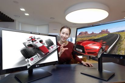 A model reaches out to grab 3D objects protruding out of LG's 25-inch Glasses-Free 3D monitors