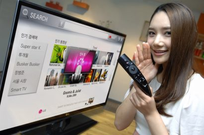 A model demonstrates LG's new Magic Remote with LG's CINEMA 3D Smart TV