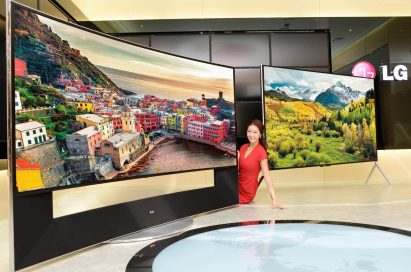 A model demonstrating LG CURVED ULTRA HD TV model UB9800