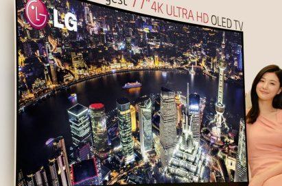 A model presenting LG's record-breaking 77-inch 4K ULTRA HD OLED TV