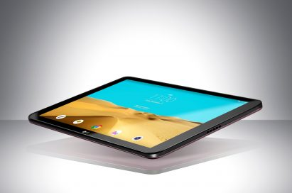 A LG Pad II 10.1 is floating in the air with its screen on above a table.