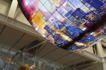A ceiling installation of LG OLED Signage displaying a city's skyline at night on display at Incheon International Airport