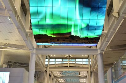 A ceiling installation of LG OLED Signage delivering the wonders of the aurora borealis to travelers at Incheon International Airport