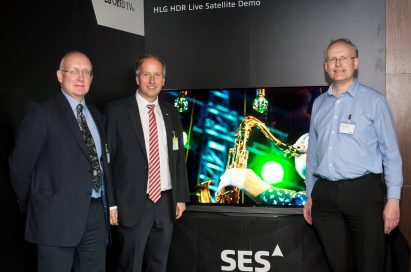 Officials of LG, BBC and SES pose in front of an LG OLED TV at the ninth SES Industry Days conference in Luxembourg