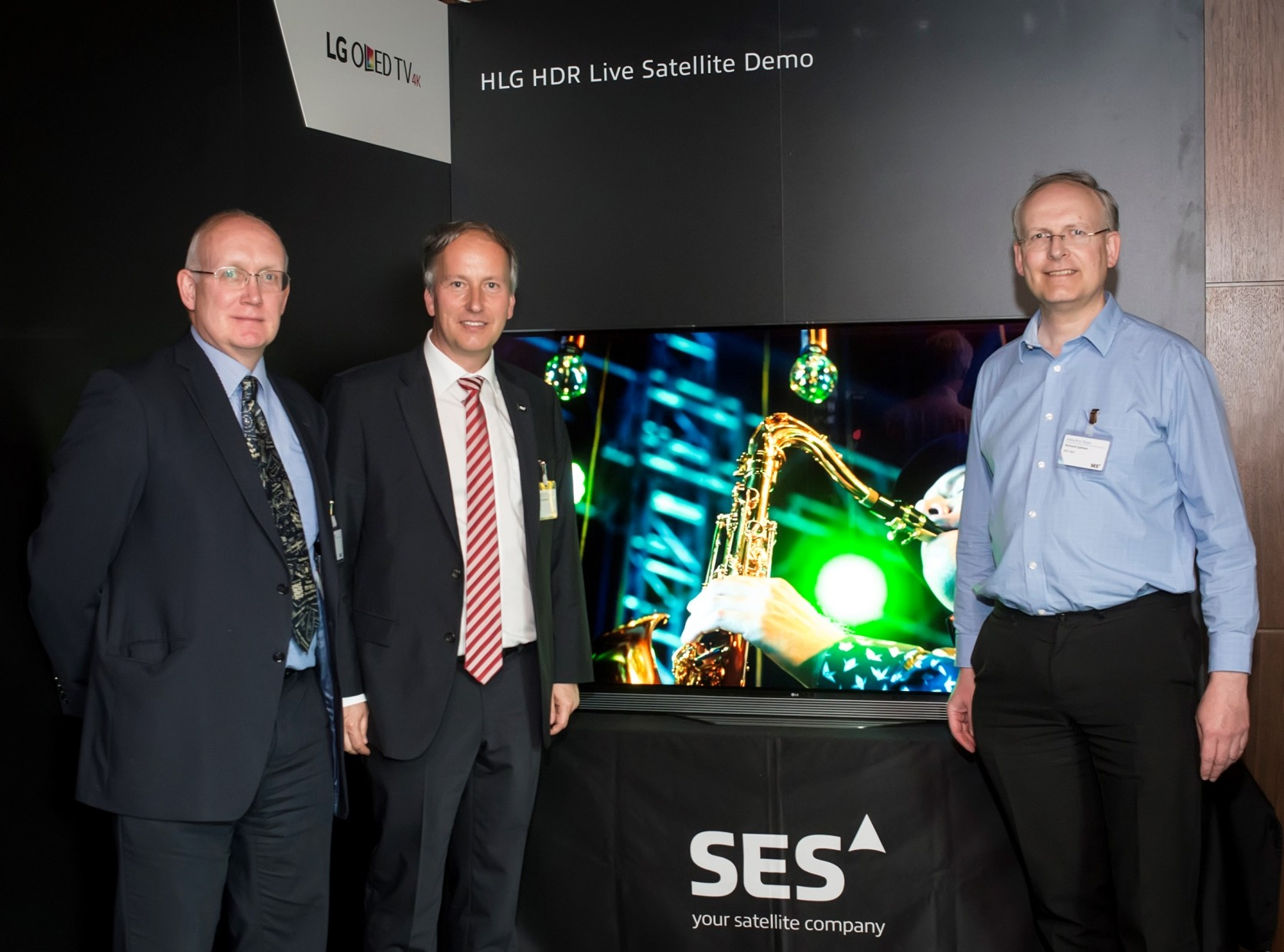 Officials of LG, BBC and SES pose in front of an LG OLED TV at the ninth SES Industry Days conference in Luxembourg.