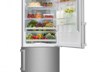 LG Centum System™ bottom-freezer refrigerator with refrigerator door opened. It's filled up with various foods including beverages, sauces, fruits and vegetables.