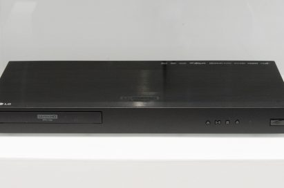 Front view of the LG UP970 Ultra HD Blu-ray player on a white table