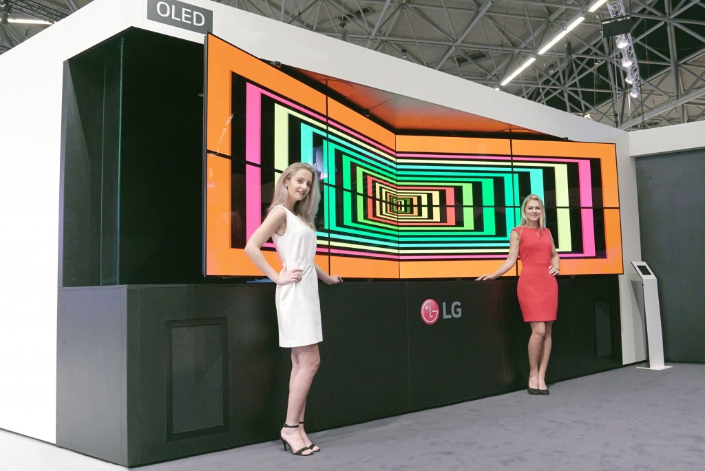 Two models are presenting LG Flexible Open Frame OLED Singage.