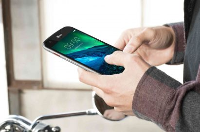 A man holding the LG X venture in Black in his hand