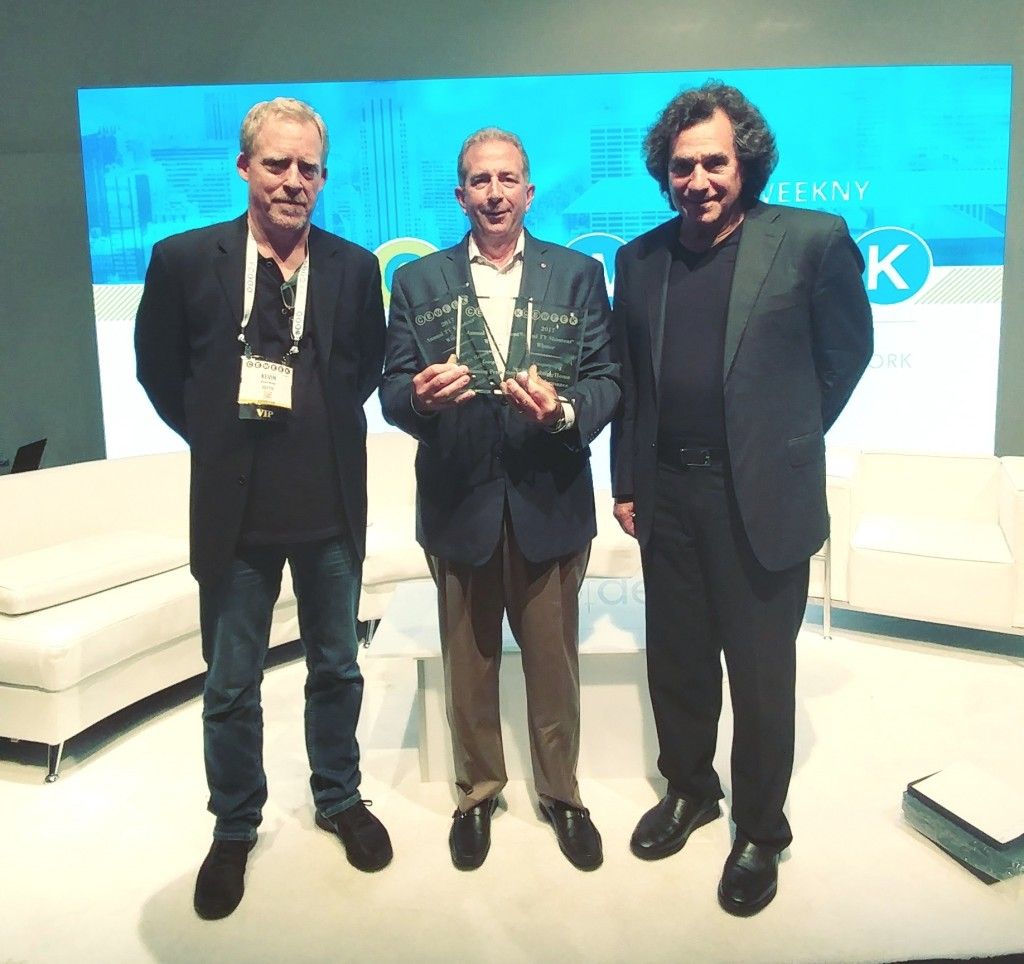 Officials of LG and CE Week are presenting three '2017 King of TV' plaques at the 14th Annual CE Week TV Shootout.