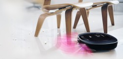 LG HOM-BOT Turbo+ navigating its way under two chairs