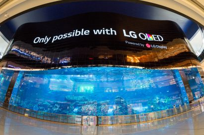 A gigantic LG OLED video wall signage displaying the message, 'only possible with LG OLED,' at the Dubai Aquarium