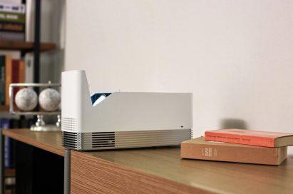 The LG ProBeam Projector model HF85J on a desk