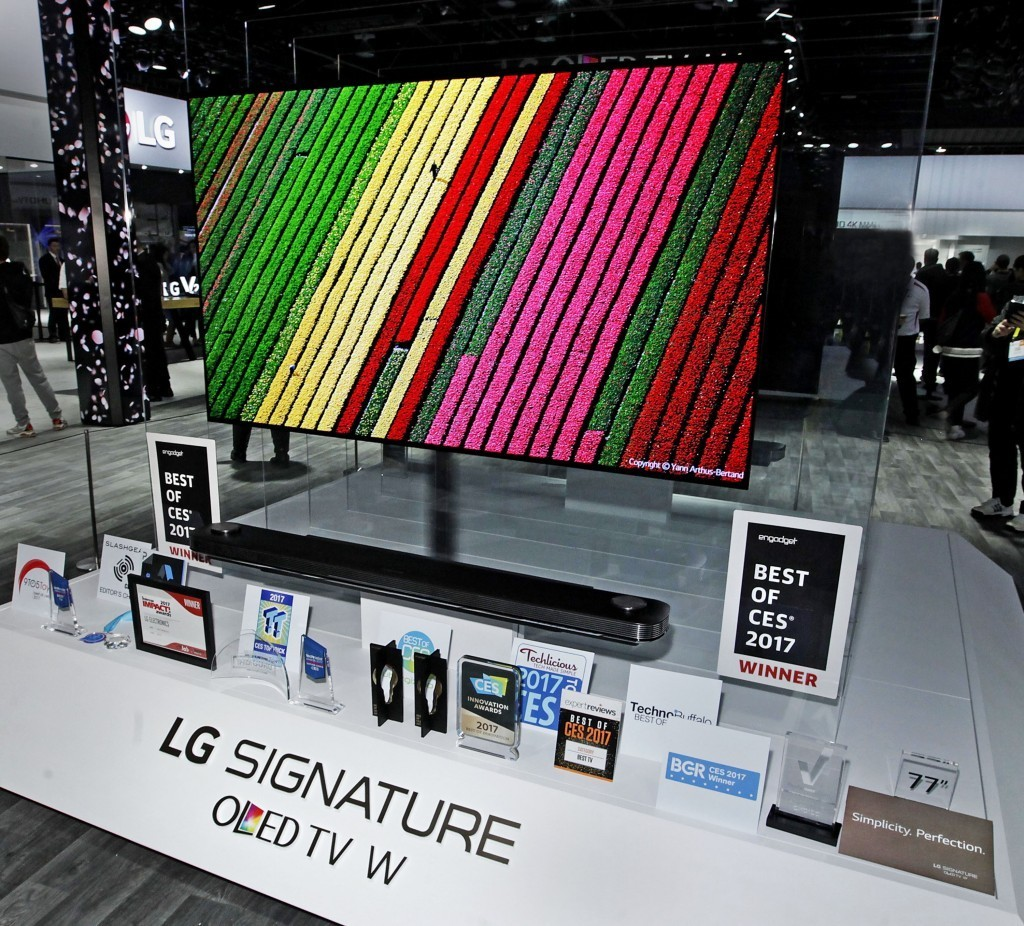LG SIGNATURE OLED TV W on a display stand surrounded by industry awards and media accolades at LG's booth during IFA 2017