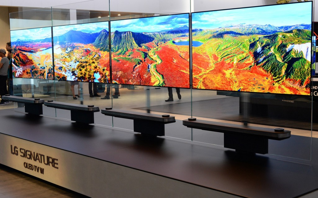Four LG SIGNATURE OLED TV Ws displaying optimized colors on show at IFA 2017.