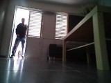 A screenshot of footage recorded by LG HOM-BOT robot vacuum cleaner shows the moment a thief breaks into the user's home.