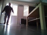 Another screenshot of footage recorded by LG HOM-BOT robot vacuum cleaner shows the moment a thief breaks into the user's home.