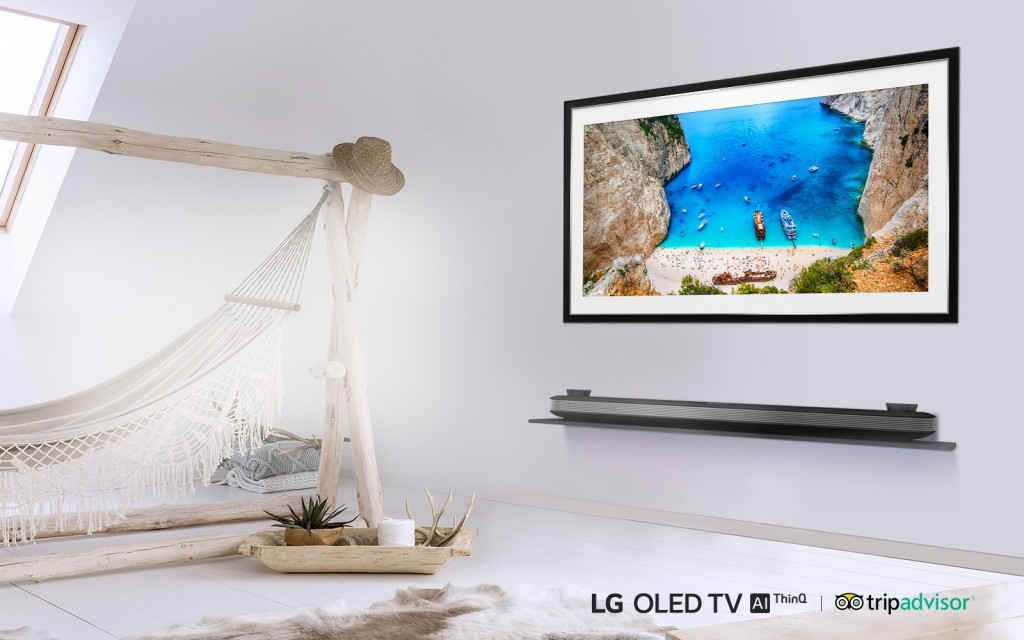 LG SIGNATURE OLED TV W in a room with a hammock displaying an image of boats on the coast of a rocky island.