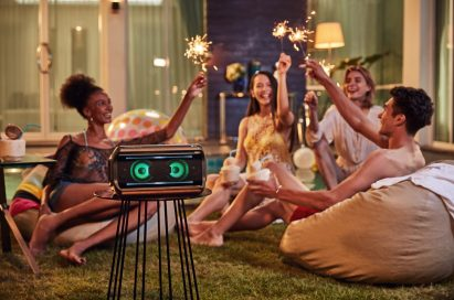 Young people throwing a party with the LG XBOOM Go on the table