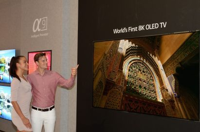 Two models admiring the world's first LG 8K OLED TV at IFA 2018