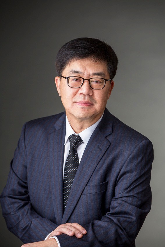 A headshot of president and chief technology officer of LG Electronics, Dr. I.P. Park.