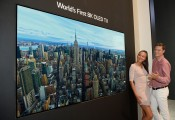 World's First 8K OLED TV display at IFA 2018, with a male and female model standing on the right side