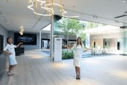 Another wide-angle view of the LG Signature Kitchen Suite display zone, two models are pointing the way inside