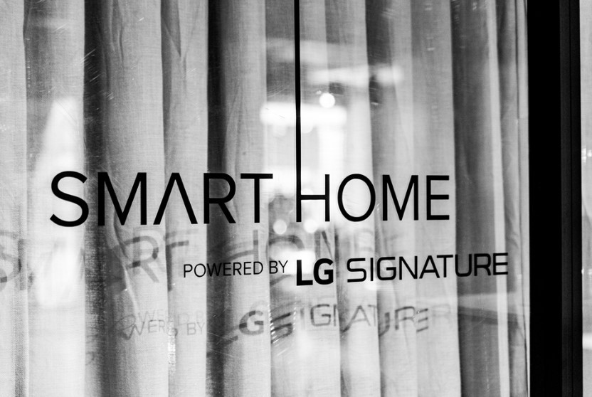 "The logo of the ""Smart Home powered by LG SIGNATURE"" attached on the glass at the event zone"