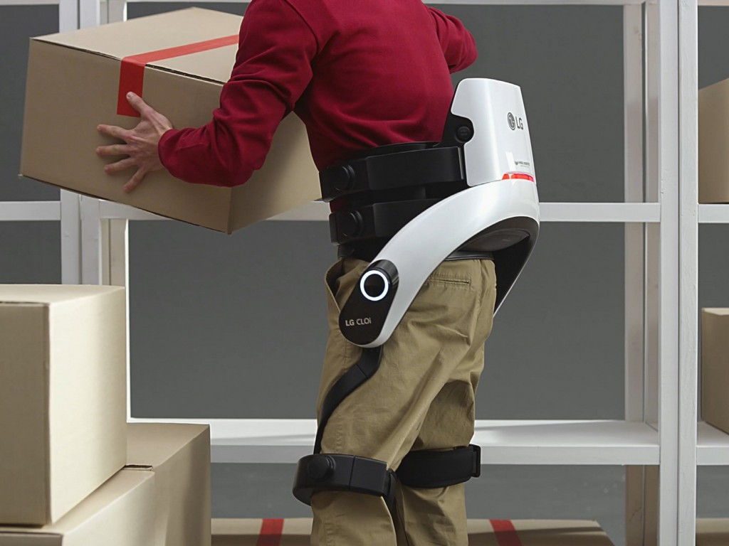 Close up of man lifting box while wearing the LG CLOi SuitBot