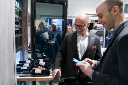 Visitors discuss the wine cellar in the ultra-luxury Signature Kitchen Suite brand.