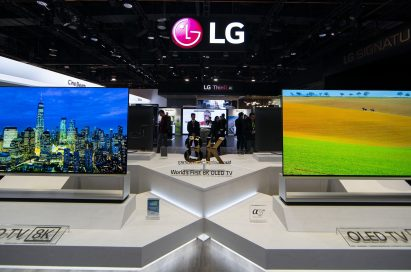 Two LG 8K OLED TVs showing vivid city views and natural landscapes displayed side-by-side