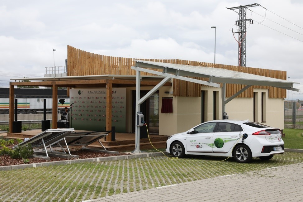 An electric car charging up at the EV charging station placed outside the LG LG Hanok ThinQ & Passivhaus