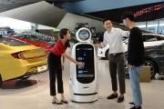 Three visitors interact with LG CLOi GuideBot in front of vehicles at Hyundai Motor Studio Goyang.