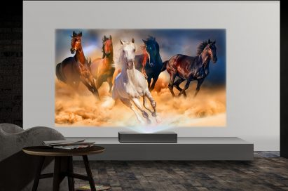 A view of LG CineBeam 4K UHD projector model HU85L producing images of running horses in a low-lit room