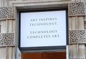 "An LG-sponsored billboard saying, ""Art Inspires Technology. Technology Completes Art."""