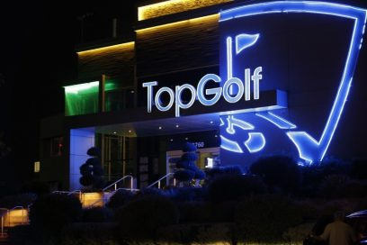 A far shot of a Topgolf venue's entrance
