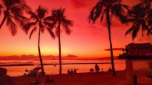 An image taken by LG G8X ThinQ perfectly captures Waikiki beach's glowing red and orange sunset.