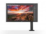 Front view of LG UltraFine Monitor 32UN880 perfectly displaying a colorful, highly detailed photo of a sunrise landscape