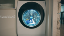 A front view of the LG SIGNATURE TwinWash washing machine running its Personalized Washing Cycle and Fabric & Stain Type Detection functions