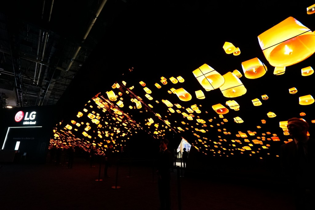 A wide-angle shot of LG Wave in the dark displaying hundreds of glowing lanterns rising into the night sky at CES 2020