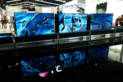 A closer look at three of the LG SIGNATURE Rollable TVs (R) being showcased in their full-view mode at the company's CES 2020 booth