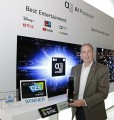 Tim Alessi, LG US's head of marketing, holding up a Best of CES award in front of the company's a9 Gen3 AI Processor display at CES 2020