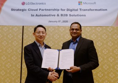 Dr. Lee Sang-yong, senior vice president and head of LG's Automotive & Business Solutions Center, shakes hands with Microsoft's Sanjay Ravi to commemorate their new partnership to accelerate the digital transformation of B2B Business