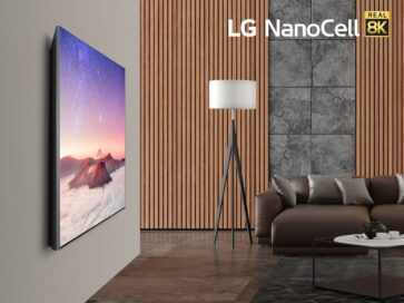 Left-side view of LG's 75-inch 8K NanoCell TV model Nano99 hanging on the wall of a cozy living room, with the LG NanoCell Real 8K logo in the top-right corner of the image