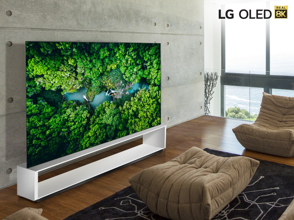 LG 8K OLED TV model 88 OLED ZX in a modern living room while displaying the vivid colors of a dense green forest.