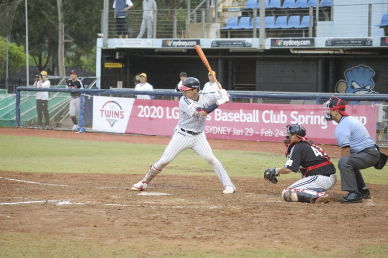 An LG Twins baseball player winds up as he tries to hit a baseball out the park
