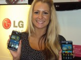 A woman holds up two LG Optimus 2X smartphones powered by the NVIDIA® Tegra™ 2 mobile dual-core processor and also the world's first dual-core smartphone at MWC 2011