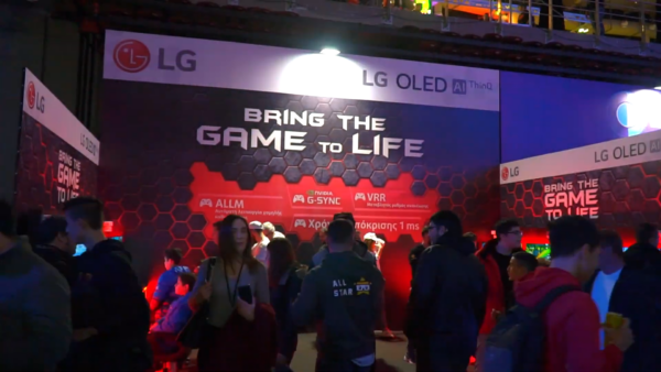 The LG OLED AI ThinQ booth at Gameathlon 2020 displaying the 'Bring the Game to Life' slogan as numerous attendees check out LG's latest TVs and monitors